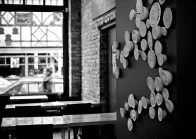 Installation at Stage Wine Bar.  100 components.  Porcelain.  2012.  Photo credit - Cathie Ferguson