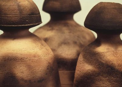 Elusive Containment.  3 figures detail. Smoke Fired Stoneware.  2006