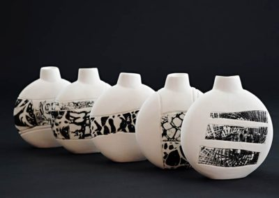 Bottles.  Porcelain, photo transfer.   2016.  Photo credit: Cathie Ferguson