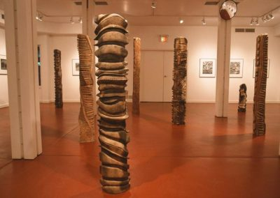 "Two Rivers.  Campbell River Public Art Gallery.  Stand Installation.  11 towers, up to 83"" tall.  2005"